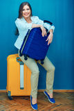Happy woman sitting on suitcase. Stock Images