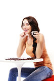 Happy woman sitting on a table with espresso coffe Royalty Free Stock Images