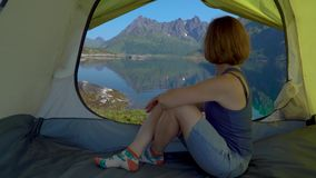 Happy woman sitting in a tent stock footage
