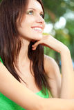 Happy woman sitting under the tree closeup face Royalty Free Stock Photos
