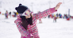 Happy woman on ski holiday waving Royalty Free Stock Photo