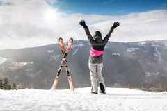 Happy woman skier in mountains with ski, High mountain Royalty Free Stock Photo