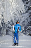 Happy woman skier on a ski slope in the forest Royalty Free Stock Photos