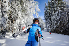 Happy woman skier on a ski slope in the forest Stock Image