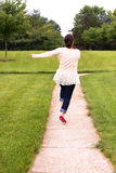 Happy Woman Skipping on the Walkway Royalty Free Stock Images
