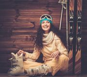 Happy woman with skis and ski boots Royalty Free Stock Images