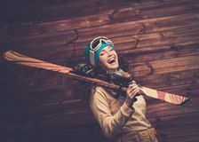 Happy woman with skis Royalty Free Stock Image