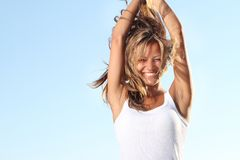 Happy woman on sky background Stock Photos