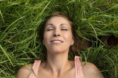 Happy woman sleeping in meadow Royalty Free Stock Image