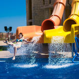 Happy woman sliding water park Royalty Free Stock Images