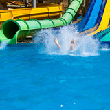 Happy woman sliding water park Stock Photo