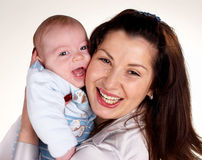Happy woman with the small child on hands Royalty Free Stock Photography