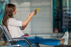 Happy woman with small model airplane and Royalty Free Stock Photography