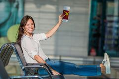 Happy woman with small model airplane and Royalty Free Stock Photo