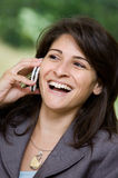 Happy woman on smartphone Stock Images