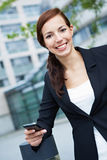 Happy woman with smartphone Royalty Free Stock Photos