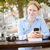 Happy Woman with a Smartphone Royalty Free Stock Photo