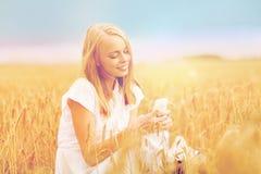 Happy woman with smartphone and earphones Stock Photo