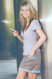 Happy woman with smartphone smile face portrait Stock Photography