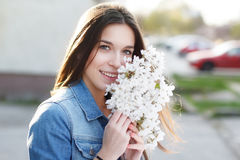 Happy woman smell cherry flower Royalty Free Stock Photos
