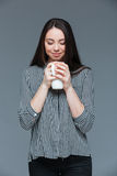 Happy woman smelling aroma of coffee Stock Image