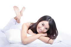 Happy woman smile face while lying on the bed