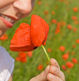 Happy woman smile with poppy Stock Image