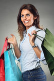 Happy woman smiles while shopping Royalty Free Stock Photos