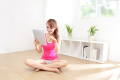 Happy woman smiles using tablet pc Stock Images