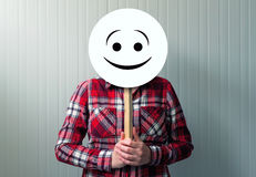 Happy woman with smiley emoticon Royalty Free Stock Photography