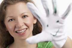 Happy woman with smiley on her glove Stock Image