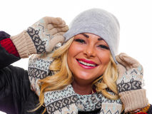 Happy woman smiling. A attractive woman dressed for winter is smiling looking into the camera stock photography