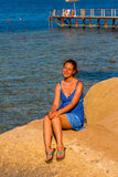 Happy woman smiling at the beach on a sunny day Royalty Free Stock Photography