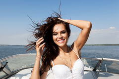 Happy woman smiling on boat stock photos