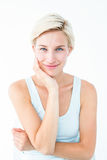 Happy woman smiling at camera with hand on cheek Stock Photography