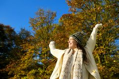 Happy woman smiling and enjoying an autumn day outdoors Stock Image