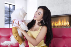 Happy woman smiling at her dog at home Stock Photography