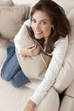 Happy Woman Smiling Holding Cushion At Home Royalty Free Stock Images