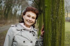 Happy woman smiling in a park Royalty Free Stock Photo