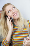 Happy woman smiling on the phone Stock Image
