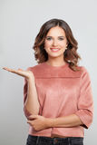 Happy Woman Smiling and Showing Empty Copy Space Royalty Free Stock Images
