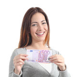 Happy woman showing a five hundred euros banknote. Happy woman smiling and showing a five hundred euros banknote on a white isolated background Stock Photo