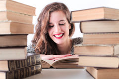 Happy woman smiling while studing Royalty Free Stock Photo
