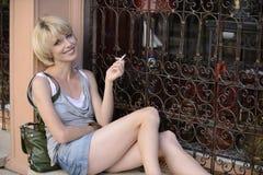 Happy woman smoking a cigarette Stock Photo