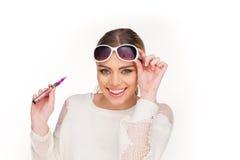 Happy woman smoking e-cigarette Royalty Free Stock Image