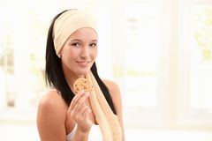 Happy woman in snood holding cookie Stock Image