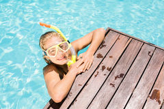 Happy woman with snorkel gear leaning on pool side Stock Photography