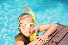 Happy woman with snorkel gear leaning on pool side Royalty Free Stock Photo