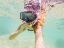 Happy woman in snorkeling mask dive underwater with tropical fishes in coral reef sea pool. Travel lifestyle, water. Sport outdoor adventure, swimming lessons stock images