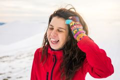 Happy woman on a on snow covered mountain stock photography